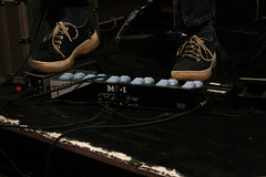 Photo of Steve Lawson's feet, operating a looperlative, at a Recycle Collective gig. Photo taken by Steve Brown