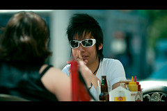 Patio Conversation... (Dom Cruz) Tags: street portrait people ontario canada reflection guy girl sunglasses canon spring cafe couple downtown afternoon dof bokeh candid guelph streetphotography patio shade cinematic f20 135l canonef135mmf2lusm 40d canoneos40d