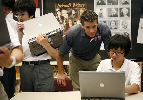 Faculty checks Fujitsu lifebook for homework at St. Andrew's College