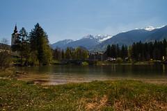 By the lake (Karmen Smolnikar) Tags: bridge trees lake mountains church water hotel slovenia slovenija bohinj tnp triglavnationalpark yourwonderland