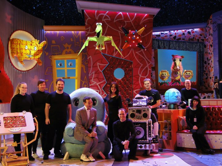 Pee-wee Herman poses with the Swazzle puppeteers
