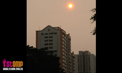Reddish sun in S'pore: Could haze and bush-fires be the cause?
