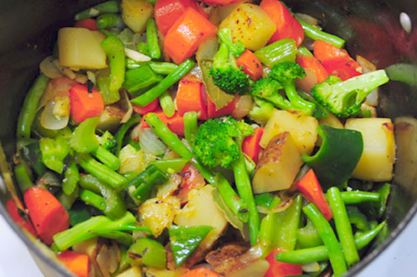 vegetables sauteeing for chicken and noodle soup