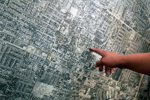 Image: finger pointing at map.