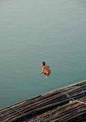 boy jumping off a bamboo raft in Sangkhlaburi Thailand (jitenshaman) Tags: boy lake jump dive sangkhlaburi