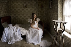 Mrs. Haversham sits waiting still (moggierocket) Tags: wallpaper house green abandoned window girl bride bed bedroom waiting belgium story d200 weddingdress snowwhite dickens chiaroscuro greatexpectations silentalltheseyears fivestarsgallery infinestyle mrshaversham thinkthiswouldmakeagreatbookcover