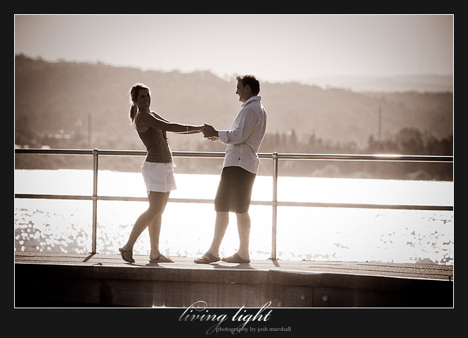 Holding hands on the jetty. Engagement session at Speers Point, Lake Macquarie, Newcastle.