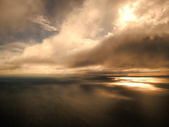 Flight from the Fire (ecstaticist) Tags: ocean sea usa cloud mountain seascape canada reflection vancouver photoshop canon georgia skyscape de island fire washington marine raw ship bc juan state ripple wave wideangle ps victoria helicopter commute olympic shipping range hdr strait fuca photomatix tonemapped g10 pseudohdr evanstyle