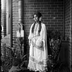 Portrait view of woman in fancy dress thumbnail