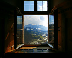 View through a window at Hohenwerfen color (mercolino) Tags: wood mountains salzburg castle window rio montagne ventana austria madera fiume ombra sombra finestra shade montaa castello castillo hdr hohenwerfen legno salisburgo werfen rier theunforgettablepictures salsburgo
