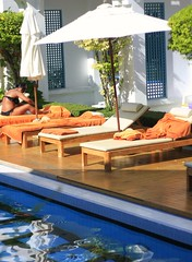 Poolside (chrisamichaels) Tags: ocean wood blue orange cloud sun beach pool umbrella canon thailand monkey honeymoon bangkok lounge snorkeling bikini jungle chase samui phuket canopy koh zipline hardwood phiphiisland towell 40d