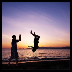 Flipping my Brother (Dave Bryson) Tags: ocean sunset playing beach kids vancouver nikon bc flip englishbay cls sb800 d700