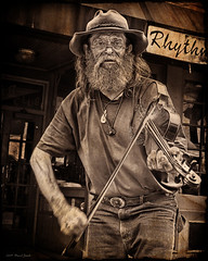 Fiddler (djrockout) Tags: old portrait blackandwhite bw musician music motion sepia canon vintage austin blackwhite cowboy artist texas natural antique grunge oldman entertainment violin western expressive fiddle aged distressed decayed fiddler streetmusician demented oldwest lucis ttv 40d theunforgettablepictures top20texas