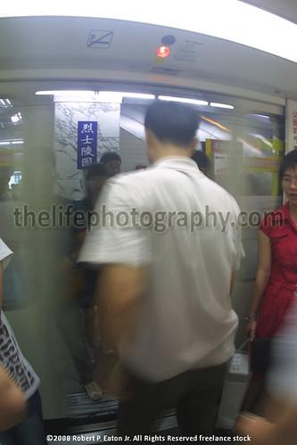 Man Departing Guangzhou Subway Into Boarding Commuters