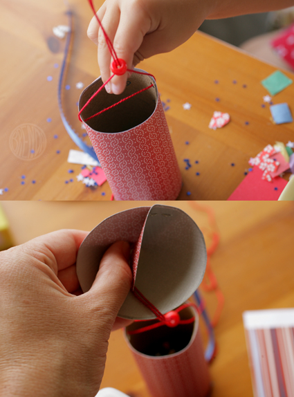 Attaching cone to confetti popper rocket