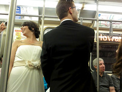 Just married, then grab the Red Line (Steven Vance) Tags: wedding tattoo train subway couple cta dress howard marriage grand passengers tuxedo transportation l justmarried addison heterosexual redline limousine bombardier chicagotransitauthority 5000s cubbybear