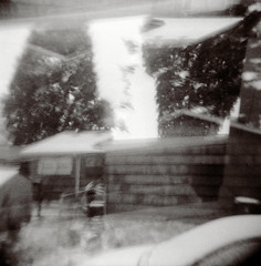 Snowcrash (Dead  Air) Tags: trees sky blackandwhite house snow car yard snowflakes holga surreal snowing sciencefiction nealstephenson exposures snowcrash snowpocalypse