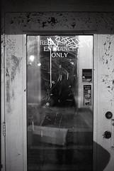 Restaurant Enterance Only (jakedavidrohde) Tags: door city light urban blackandwhite bw 3 snow wisconsin canon shopping concrete eos alone grafitti delta milwaukee walls 3200 wi ilford ilforddelta3200 canoneos3 canonef50mmf18ii ilfordilfotecddx