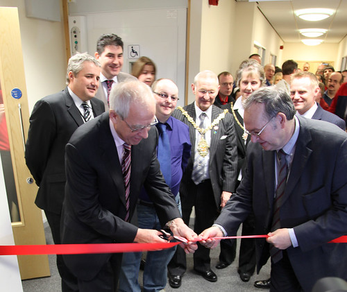 P Coates cutting the ribbon to open the Riverside Centre