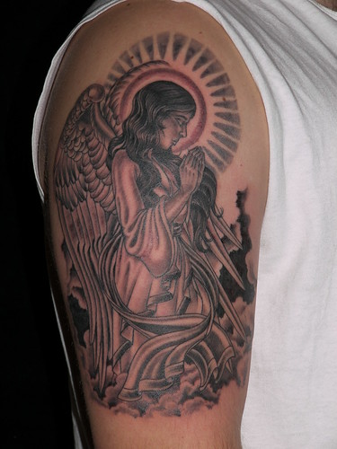 black and grey angel and clouds tattoo upper arm