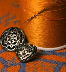 Textural Study (j.towbin ©) Tags: buttons decorative thread needle fabric textile spoolofthread sewing silver orange blue pattern texture heart heartshapedbutton week30fromtheheart texturedtuesday explore explored orangeblue colorcolor2 7daysofshooting allrightsreserved©