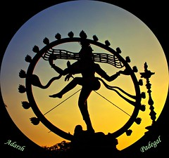 the Cosmic Dancer.. (Adarsh Padegal) Tags: blue sunset orange india silhouette statue dance god dusk dancer destroyer hues ap hyderabad shiva hindu andhra yello rhythm adarsh pca hpc rudra lasya telugu andhrapradesh nataraj cosmicdancer adarshpadegal thandava shilapakalavedika halfbluehalforange