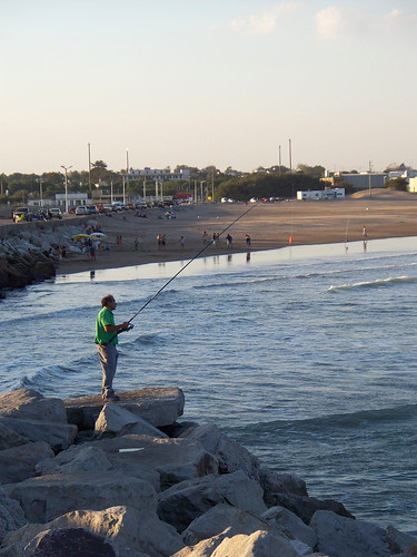 Fishing on the North Jetty | Pescando en la Escollera Norte by katiemetz, on Flickr