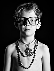 droppin' beats (b*wag) Tags: boy portrait blackandwhite bw gold glasses necklace yo blingbling chain bling explored strobist dollabillyall