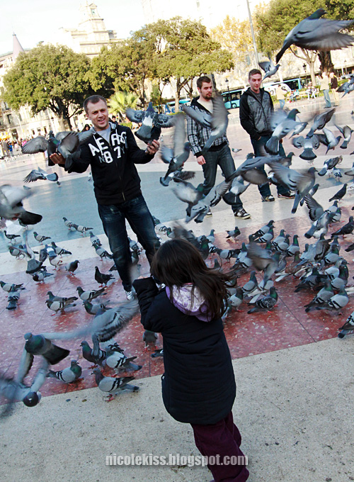 man and little girl and pigeons