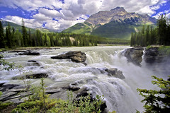 Athabasca Falls - The Broad View (woodchuckiam) Tags: travel sky mountain canada nature clouds river waterfall rocks jasper scenic waterfalls alberta cascades hdr athabascariver jaspernationalpark athabascafalls athabasca icefieldsparkway canadianrockies aplusphoto worldtrekker absolutelystunningscapes guasdivinas mwqio woodchuckiam