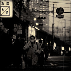The Walk Home; Evening commuters in Kanda, Tokyo (Alfie | Japanorama) Tags: road street old ladies blackandwhite woman signs man cute men home girl monochrome lines station sign japan lady night work walking square asian japanese mono tokyo evening workers nikon women asia pretty power phone candid telephone young railway commute mobilephone kanda commuting talking calling toned gents commuters gentlemen d300 nikkor85mmf14daf