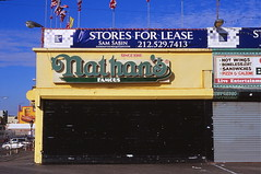 Nathan's Famous... for lease (i mei) Tags: winter ny brooklyn 35mm coneyisland nikon f100 slidefilm lonely deserted january2009 imeiimei