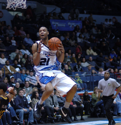 Sammy Monroe of the Rochester Razorsharks gets some air as he goes up for a reverse dunk.  Photo by Chuck Miller.