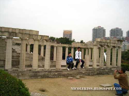 people posing on the acropolis of athens replica