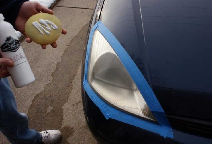 Spread Meguiar's M105 generously on foam applicator pad