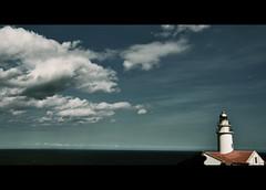 EL FARO (RominikaH) Tags: ocean sky clouds faro libertad freedom mar mujer women mediterraneo cielo nubes soledad mallorca horizonte oceano solitaria flickraward rominikah