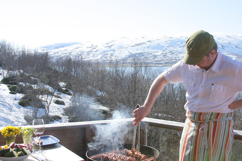 Barbeque with snow on mountains and in garden