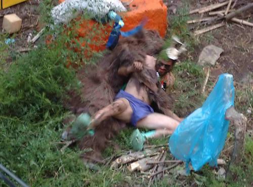 Andrew Brehm wrestling with hairy rug monster