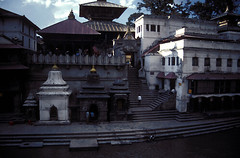 NEP_KTM.157 (photonogrady) Tags: nepal people cloud heritage monument stone architecture stairs river temple pagoda dock stair pierre riviere religion kathmandu shiva nuage hinduism quai pilgrimage escalier gat contrejour backlighting pashupatinath patrimoine ghat pagode personnage hindouisme pelerinage bagmati kathmandou