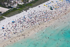 Spring Break 2009 on South Beach, Miami Beach (MaydayRelay) Tags: ocean vacation beach sand aerial helicopter springbreak 85mmf12 swimmers miamibeach umbrellas southbeach crowded sobe 5dmarkii