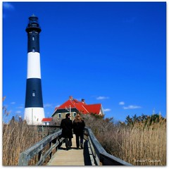 Fire Island Lighthouse (Ronaldo F Cabuhat) Tags: pictures birthday new york travel bridge blue roof friends light shadow red vacation sky brown lighthouse tower love nature beautiful beauty grass canon walking photography high wind walk candid bluesky pic images romance longislandny lovers walkway precious coastline moment breeze woodenbridge partner lighttower fireisland nationaltreasure clearsky redroof drygrass greatsouthbay fireislandlighthouse fireislandnationalseashore historicallighthouse longis longislandnewyork canoneosdigitalrebelxti pinoykodakero beautifullighthouse cabuhat fireis