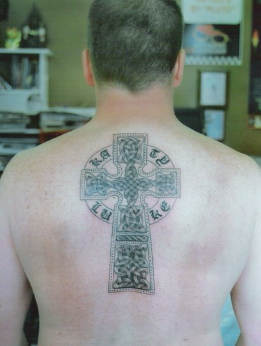 irish celtic cross tattoo with names in gothic lettering by dublin ireland