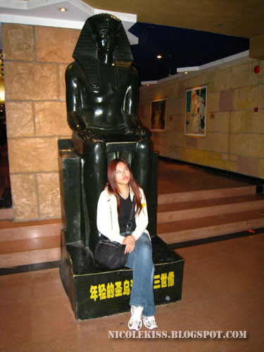 sitting on egyptian statue