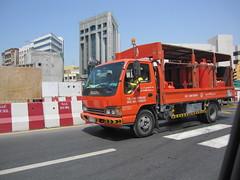 IMG_4337 (shimmertje) Tags: orange truck scarlet al dubai bur united uae gas emirates arab vermilion canisters isuzu hamriya
