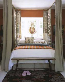 Pattern mix: Orange bedroom + taupe + white + bed curtains