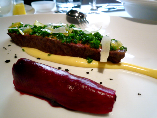 Roasted wagyu rump, cherries, candied lemon, chives, egg yolk