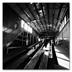 One of our lifeboats is missing (s0ulsurfing) Tags: wood light blackandwhite bw sunlight white black history lines dark square island grey mono march pier wooden missing interior patterns jetty wide perspective wideangle monotone gone vectis isleofwight cropped inside isle 2009 beams squared wight rafters bembridge 10mm sigma1020 s0ulsurfing aplusphoto bembridgelifeboatstation eastwight bembridgelifeboat bembridgebay