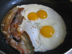 Organic bacon and eggs with a double yolk