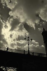 Sevilla. Puente de Triana desde el muelle _ Triana Bridge from the wharf (Regina Martnez/ Off/ Pensando/ Thinking) Tags: sky clouds landscape sevilla bridges paisaje cielo nubes puentes bwphoto reginamartnez
