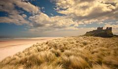 Bamburgh (Ray Byrne) Tags: sea castle beach coast sand dunes sunny northumberland shore bamburgh bamburghcastle raybyrne byrneoutcouk webnorthcouk
